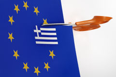 Greece exit Euro union. Cut down the Greek flag is the flag of the European Union Stock Images