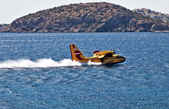 Greece fire protection aircraft Bombardier 415. Take a water from the sea, Attika, Jily, 2012. This year there were big wildfires near Athens royalty free stock image