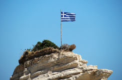 Greece flag on the cliff at the sea. Photo of Greece flag on the cliff at the sea royalty free stock photo