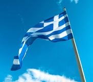 Greece flag on flagpole. Waving on sky background royalty free stock photography