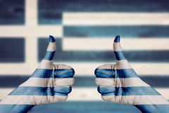 Greece flag painted on female hands thumbs up Royalty Free Stock Photos