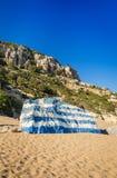 Greece flag painted on Tsambika beach rock Stock Images