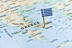 Greece flag pin on map Stock Photos