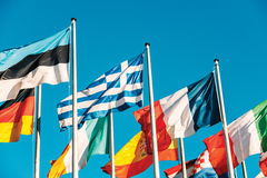 Greece flag waving in front of European Parliament Royalty Free Stock Images