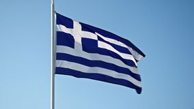 Greece flag waving in the wind against the sky stock video footage