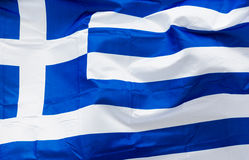 Greece flag in the wind in sunlight Royalty Free Stock Images