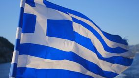 Greece flag on yacht cruise in the sea stock footage