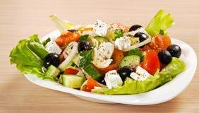 Greece fresh salad. Greece vegetable salad on a white plate stock photos