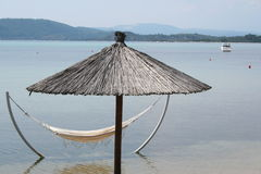 Greece. Halkidiki. Umbrella in the sea, near the beach Stock Images
