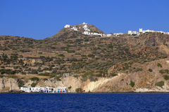 Greece hillside cliff by the water Royalty Free Stock Images