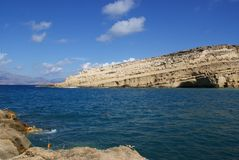 Greece, Crete, Matala, a view over the .bay to the cliffs and caves. stock photo