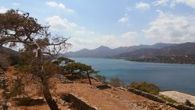 Greece. The island-fortress of Spinalonga. Beautiful view from the fortress of Spinalonga the Mirabello Bay and the island of Plaka. September 13, 2016 Stock Image