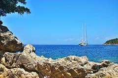Greece,island Ithaki-view of the seacoast near Kioni. View of the sailing boat and seacoast near town Kioni on the island Ithaki in Greece Royalty Free Stock Photo