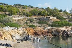 Greece. Island Of Salamis. November 5, 2017. Workers continue to. Remove  oil that spilled from the tanker Agia Zoni , sunk in the Saronic Gulf. Environmental Royalty Free Stock Images