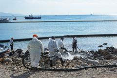 Greece. Island Of Salamis. November 5, 2017. Workers continue to. Remove  oil that spilled from the tanker Agia Zoni , sunk in the Saronic Gulf. Environmental Royalty Free Stock Photography