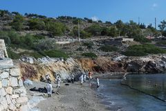 Greece. Island Of Salamis. November 5, 2017. Workers continue to. Remove  oil that spilled from the tanker Agia Zoni , sunk in the Saronic Gulf. Environmental Royalty Free Stock Photo