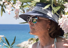 Greece. The island of Zakynthos, the Ionian Sea. Woman with a reflection in glasses of a kind on blue caves royalty free stock photography