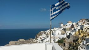 Greece at its finest!. Santorini Greece flag and landscape Stock Photo