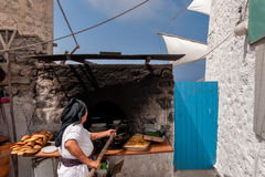 Greece Karapthos island Olympos village. Thevillage lived long in autarky until 1980. Women still cook bread in village community ovens royalty free stock image