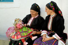 Greece Karapthos Olympos NOVEMBER 11, 2011 Agios Minas festival. Two grandmother discovers their little girl come from the united states for the festival of stock photography