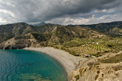 Greece, Karpathos Island Agios Minas beach. Isolated plain and beach reserved for the plantation of olive trees stock image