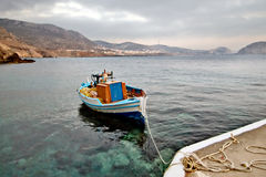 Greece, Karpathos Island Finiki village. Small port of Finiki with a raditional boat stock images