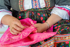 Greece Karpathos island olympos traditional clothes. Olympos woman repairs a holiday dress before Easter royalty free stock image