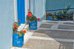 Greece, Karpathos Island Pigadia Town. Empty feta cans are used as flower pots stock photography