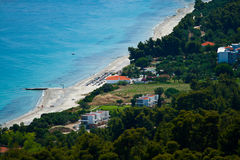Greece, Kassandra, Chalkidiki. Marine landscape. Greece, Kassandra, Chalkidiki. Blue sea and sky, small town with red roofs stock images