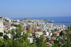 Greece, Kavala. Greece, cityscape of Kavala with fortress, harbor and cruising ship royalty free stock image