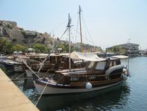 Greece, Kavala - Sertember 10, 2014. Small turists Greek boats moored to the shore stock photography