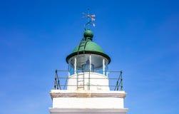 Greece. Kea island lighthouse. Lighthouse tower and weather vane on blue sky background. Greece. Kea island lighthouse. Lighthouse tower and weather vane detail royalty free stock image