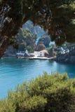 Greece landscape. Portrait framed scene of Greek church, sea and mountain rocks Royalty Free Stock Image