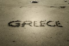 Greece, letters on the sand Stock Photo