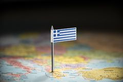 Greece marked with a flag on the map.  stock image