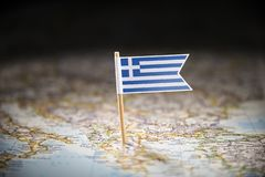 Greece marked with a flag on the map.  royalty free stock image