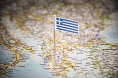 Greece marked with a flag on the map.  royalty free stock photography