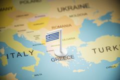 Greece marked with a flag on the map.  royalty free stock images