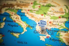 Greece marked with a flag on the map.  stock photography