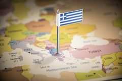 Greece marked with a flag on the map.  stock images