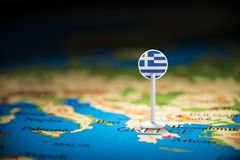 Greece marked with a flag on the map.  stock photo