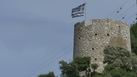 Greece Medieval Tower and Flag. On Ithaka island, in Greece stock footage