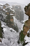 Greece. Meteora. Snow-covered Varlaam monastery. Greece. Meteora. Snow-covered Holy Varlaam monastery in a mystic winter fog royalty free stock photo