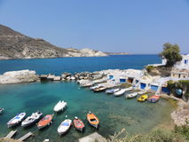GREECE MILOS ISLAND FISHERMAN VILLAGE BOATS SUMMER IN EMERALD WATERS BOAT HOUSE ISLAND Royalty Free Stock Images