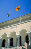 Greece. Mount Athos. Karyes. The flags of Greece and Mount Athos waving on the palace home of the Holy Community, the governing body of the Athonite monastic Stock Image