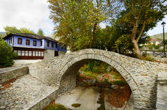 Greece, Moustheni. Greece, footbridge over river bed and colorful home in mountain village Moustheni Royalty Free Stock Photos