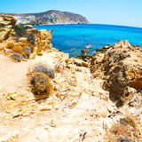 in greece the mykonos island rock sea and beach blue   sky Stock Photo
