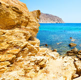in greece the mykonos island rock sea and beach blue   sky Royalty Free Stock Photo