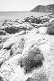 In greece the mykonos island rock sea and beach blue   sky Stock Photography