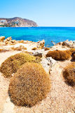 In greece the mykonos island rock sea and beach blue   sky Stock Photos